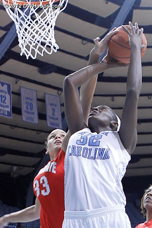 Adams gets a hand on Rolle's shot  - UNC Players: #32 Waltiea Rolle