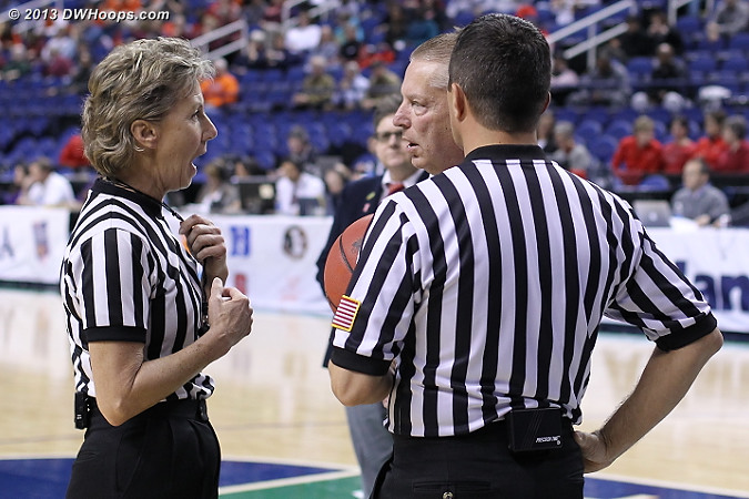Referee huddle - Joanne Aldrich, Joe Cunningham, and the back of Ed Sidlasky