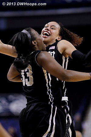 Dearica Hamby and Asia Williams celebrate as they have taken a commanding 73-56 lead with 6:51 remaining in the game  - WAKE Players: #25 Dearica Hamby, #33 Asia Williams