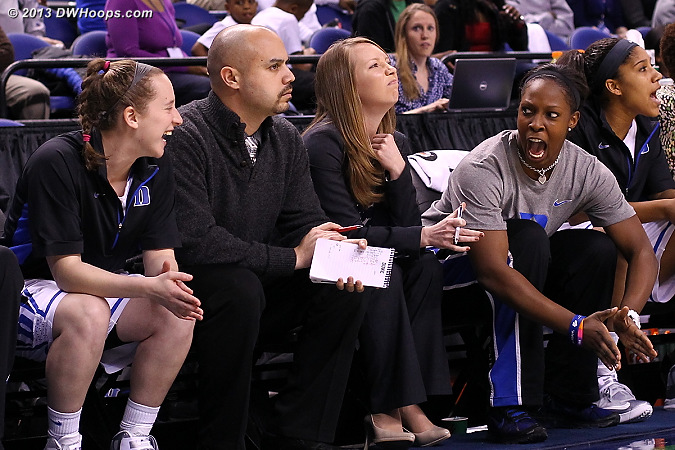 Sarah and Hernando caught in the middle of something on the Duke bench