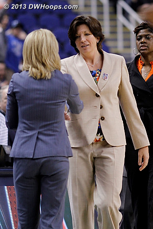 Postgame handshake  - MIA Players: Head Coach Katie Meier, Assistant Coach Octavia Blue - FSU Tags: Head Coach Sue Semrau