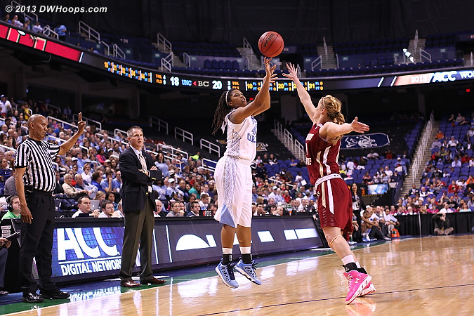 Tierra Ruffin-Pratt shoots a long two over Kerri Shields as BC Coach Erik Johnson and referee Wesley Dean watch from the sidelines  - UNC Players: #44 Tierra Ruffin-Pratt - BC Tags: Head Coach Erik Johnson, #10 Kerri Shields