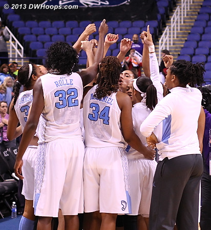 Tar Heels huddle after their 62-57 win, advancing to face Maryland in the second semifinal