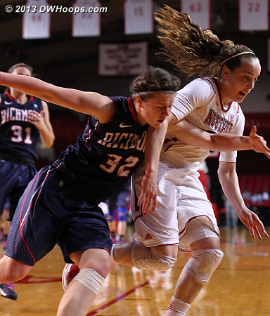 Wann and Kastanek race for a loose ball  - NCSU Players: #23 Marissa Kastanek