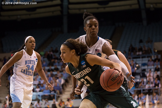Diamond goes for the steal of a Klarissa Bell baseline dribble  - UNC Players: #23 Diamond DeShields