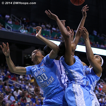 Heels swarm for a rebound  - UNC Players: #2 Latifah Coleman, #22 N'Dea Bryant, #30 Hillary Summers